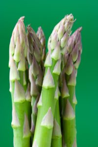 green asparagus fresh on green background nutrients from plants iron