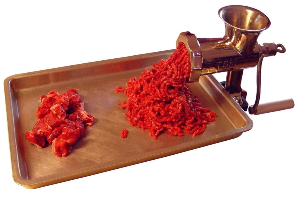 cuts of raw meat and beef in a meat grinder