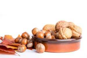 autumn nuts fall leaves in brown bowl white background nutrients from plants unsaturated fat