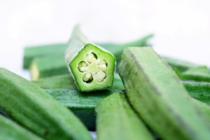 cut okra green pentagon white seeds white background nutrients from plants calcium