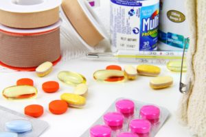 dietary supplements medicine pink pills red pills oil pills thermometer probiotics blue pills