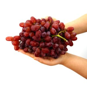 dietary myths red grapes in hands white background high sugar
