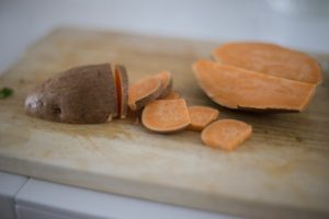 sweet potato sliced on wooden cutting board dietary myths